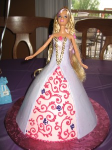 Barbie cake with gold accents and lavender dress
